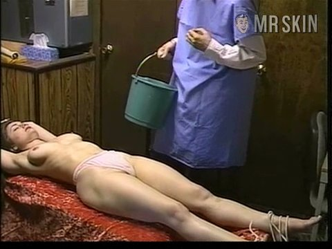 dead naked woman tied up and getting cooked